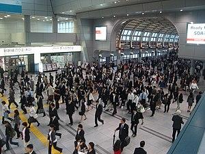 Commuters heading towards the Konan exit in Sh...