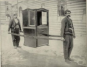 Sedan chair carried by two people