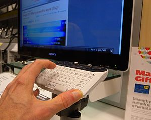 Keyboard of Sony Internet TV with hand for scale.