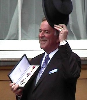 Terry Wogan receiving his knighthood at an Inv...