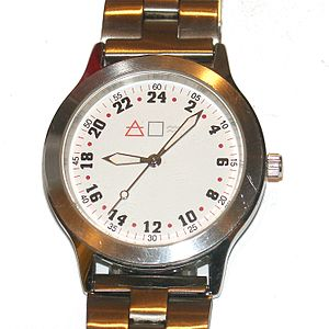 A watch with 24-hour mechanism. The hands rota...