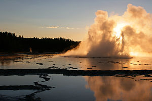 Great Fountain Geyser is erupting at sunset. Y...