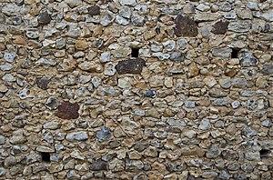 Français : mur de pierres d'une vieille ferme ...