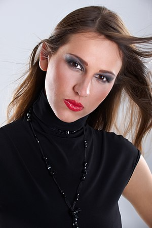 Model with eye make-up and lipstick.