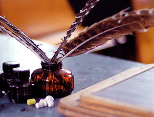 Quill pens and bottle of ink