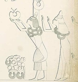 Ay and Tey in tomb 25 in Amarna receiving rewa...
