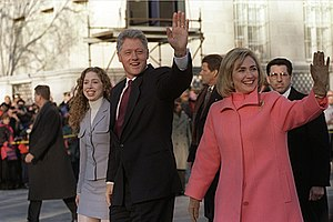 US President Bill Clinton (center with hand up...