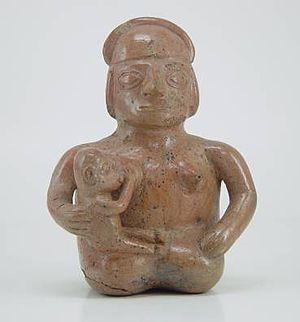 English: Moche ceramic vessel showing a woman ...