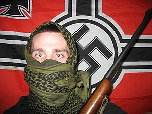 English: A militant neo nazi in USA holding a ...