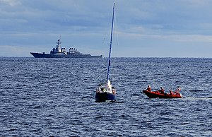 U.S. Coast Guard and Navy crews combine effort...