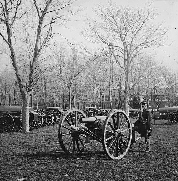 Photo by Mathew Brady, Union soldier by gun at US Arsenal, Washington DC, 1862.