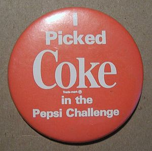 English: A Coke pin