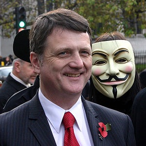 Gerard Batten MEP poses with protesters outsid...