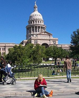 Enjoying a good book at the 2009 Texas Book Fe...