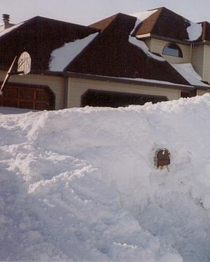 Snow bank with mailbox showing in south Grand ...