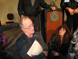 English: Bill Ayers speaks to audience members...