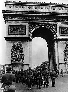 German soldiers marching past the Arc de Triomphe, 14 June 1940