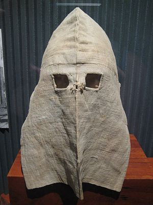ca. 1875: Calico hoods were worn by all prison...