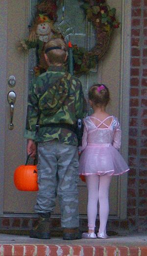 Two cousins, the boy dressed in military camou...