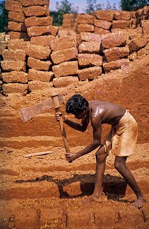 cutting of laterite brickstones. Angadipuram, ...