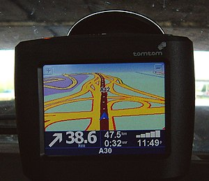 An old TomTom One in-car navigation system example direction the right way.