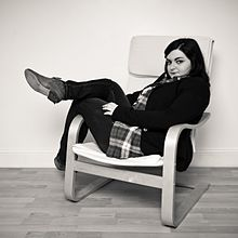 poang chairs bean bag chair cost wikipedia a woman lounging in