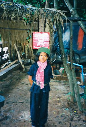 English: Child dressed up as a Khmer Rouge sol...
