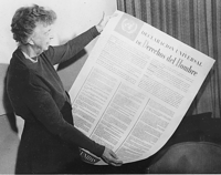 Eleanor Roosevelt with the Spanish version of the Universal Declaration of Human Rights.