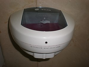 A Solos automatic soap dispenser found in a ba...