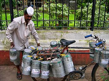 A collecting Dabbawala on a bicycle