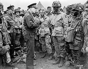 General Eisenhower speaks with members of the ...