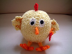 Knitted chick, hand made in Portugal.