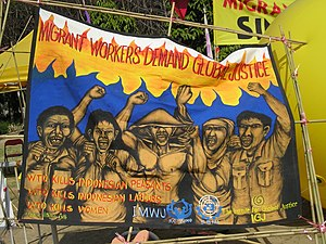 English: Anti-WTO banner by Indonesian Migrant...