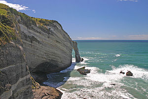 Natural arch in rocks at Cape Farewell, on nor...