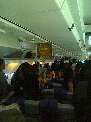 English: The Passenger Oxygen mask of CA976 fl...