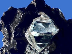 Nearly octahedral diamond crystal in matrix.