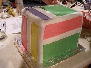 Birthday cake with hard white fondant icing as...