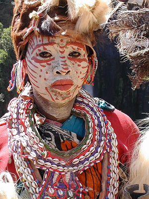 English: Kikuyu woman with face painted white ...