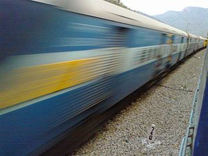 English: a moving train captured from another ...
