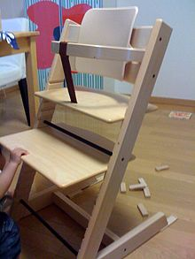 first high chair invented ivory covers for rent near me tripp trapp wikipedia type