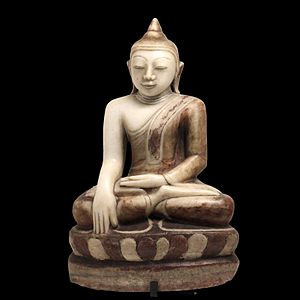 Buddha sitting in bhumisparsha-mudra posture (...