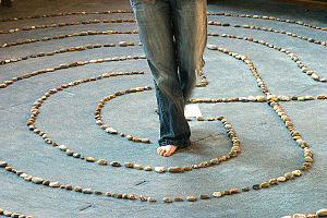 A woman walking a prayer labyrinth