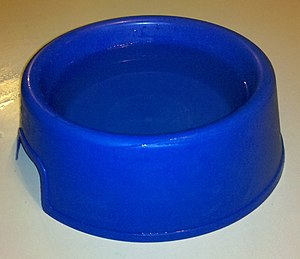 English: Large blue water bowl for dogs, half ...