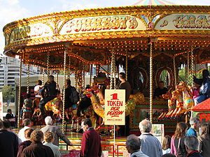 A roundabout at a fair in London, with traditi...
