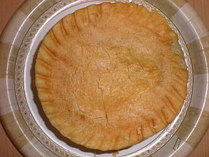 A cooked Marie Callender's chicken pot pie, ou...