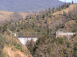 The Cotter Dam in December 2005, surrounding c...