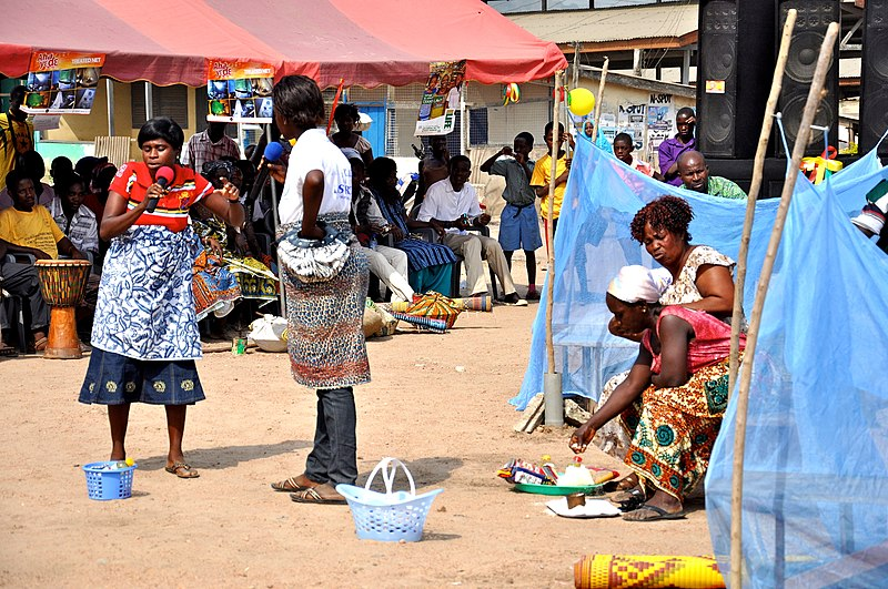 In Ghana:  Community members perform a scene to educate others on how and why to use bednets. (USAID/Kasia McCormick) 2012. USAID Africa Bureau