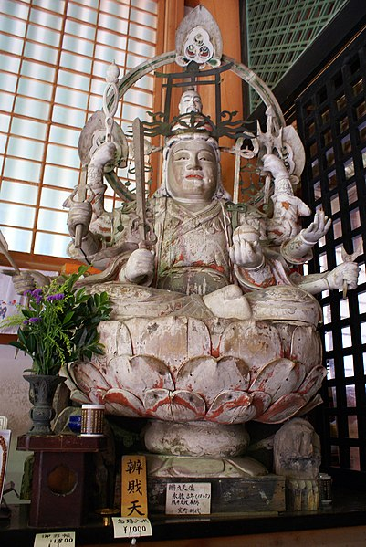 Statue of Benzaiten with a torii on her head.jpg