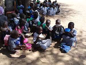 Kids in Turkana, Kenya, eating their porridge
