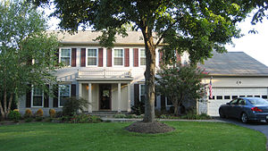 A typical colonial-style single family home in...